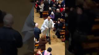 Crowd Cheers as Irish Priest Leaves Christmas Mass on Scooter