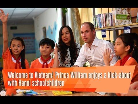 Welcome to Vietnam! Prince William enjoys a kick-about with Hanoi schoolchildren.