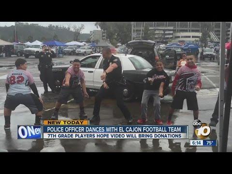 San Diego Police officer dances with El Cajon football team