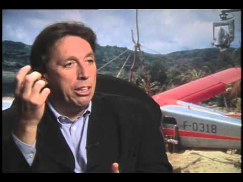 Director Ivan Reitman talks with Jimmy Carter