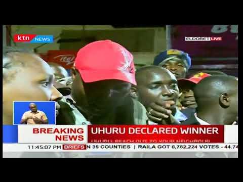 Eldoret residents react after Uhuru Kenyatta was declared president-elect in Kenya's 2017 poll