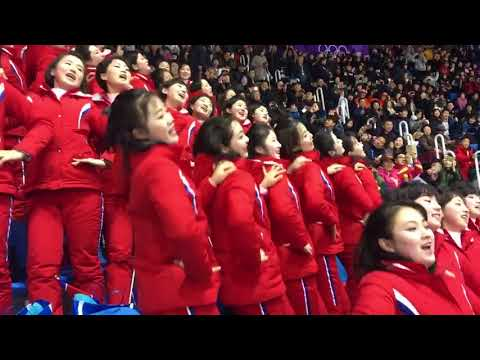North Korean Cheerleaders displaying their choreographed cheers to charm the crowd