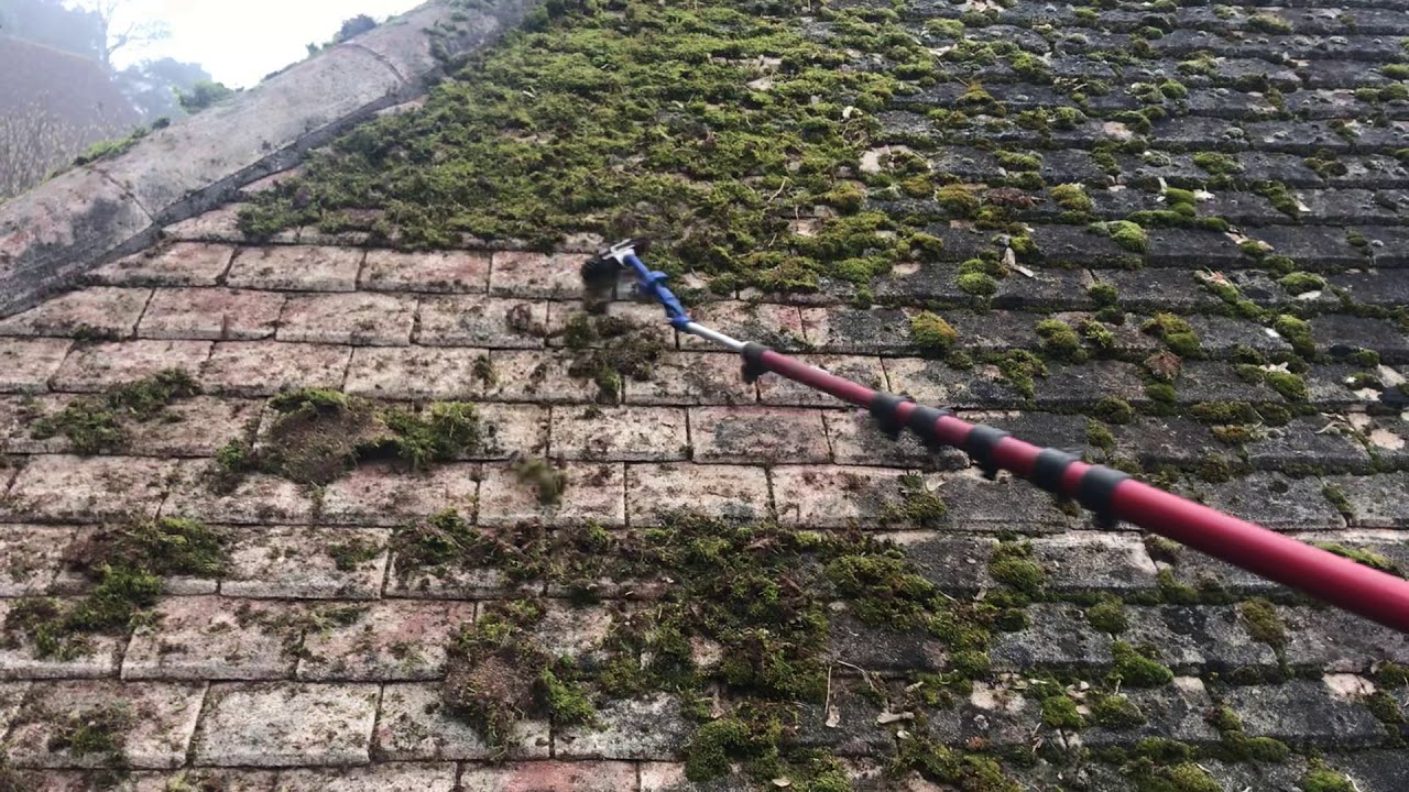 Airpole Cleaning A Moss Covered Roof Using Compressed