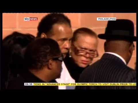 Muhammad Ali (1942 - 2016) looking frail at the funeral of Joe Frazier