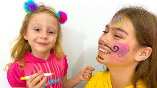 ستايسي تصنع الرسم على الوجه لمسابقة الجمال