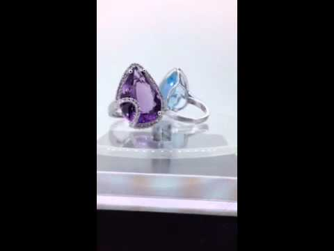 Blue topaz and purple diamond rings
