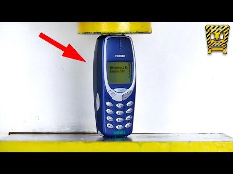 Aplastando 6 Celulares Nokia con una Prensa de 100 Toneladas (El Show de la Aplastadora)