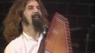 Billy Connolly playing autoharp