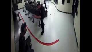 SHOCKING VIDEO - Florida Cop Throws Peanuts At Handcuffed Homeless Man Inside Police Station