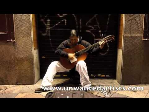 Street Artist, Busker, Madrid, Spain, South American Guitar and pipe