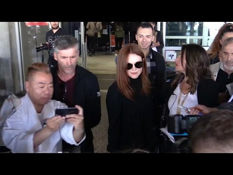 Actress Julianne Moore arriving in Cannes airport in a chaos