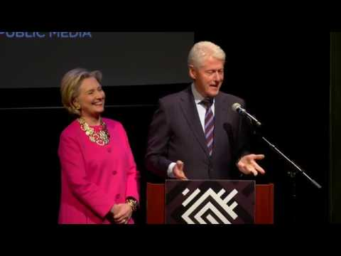 Bill Clinton and Hillary Clinton are presented with a plaque of Dr. Maya Angelou