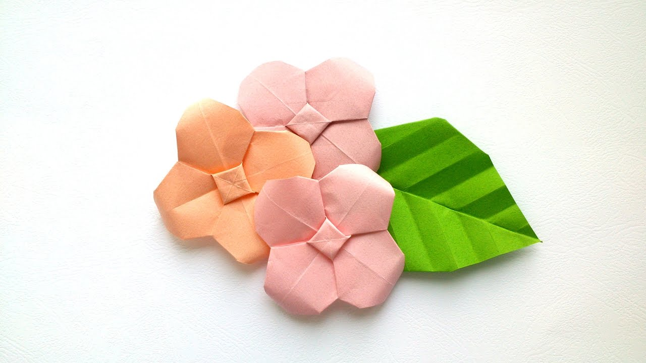 Multicolored Paper Origami Flowers On Pastel Background. Studio ... | 720x1280