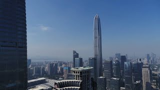 Aerial view of mega city Shenzhen in helicopter tour