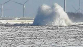 Motor Grader trying to plow through a snow drift.