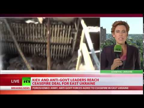 Kiev, E  Ukraine militia Agree on Ceasefire . . .