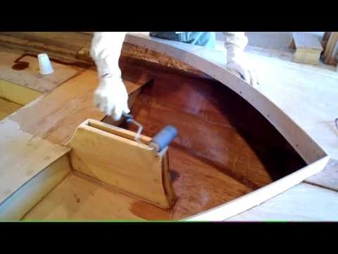 Applying an epoxy coating to a wooden boat
