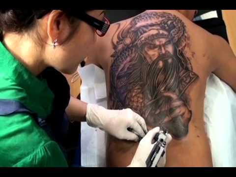Quan cong full back tattoo