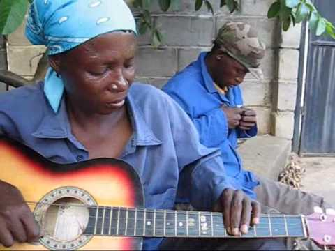 Ronnie from Botswana has an interesting way of playing the guitar