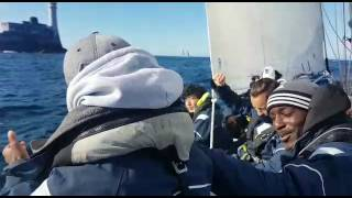 Scaramouche rounds the Fastnet Rock in the Rolex Fastnet Race