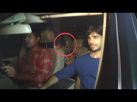 OMG! Who's Hiding Her Face In Sidharth Malhotra's Car
