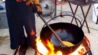 Amish man and wife making kettle cooked popcorn.