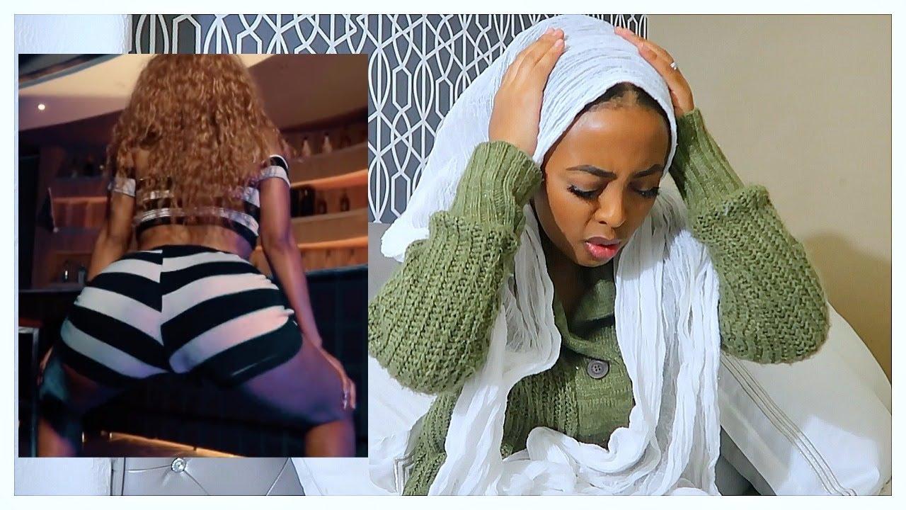 ETHIOPIAN MOTHER REACTING TO AMHARIC SONGS/ ኢትዮጲያዊ እናት ለዘንድሮ ዘፈን ያላቸዉ ኣስተያየት
