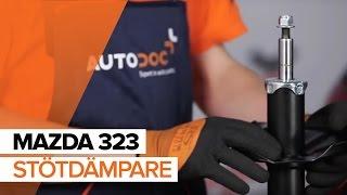 Så byter du fjäderbenslagring, stötdämpare fram på MAZDA 323 GUIDE | AUTODOC