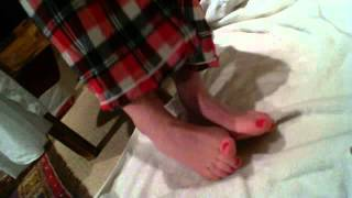 My freshly painted red toenails Thumbnail