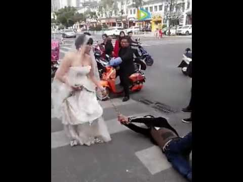 Bride drags groom through the streets in chains after he doesn't show up to wedding