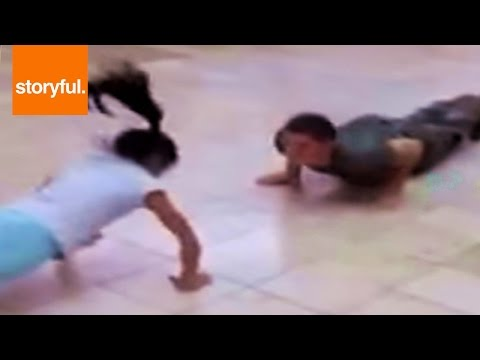 Little Girl Competes with Marine At Push Up Challenge