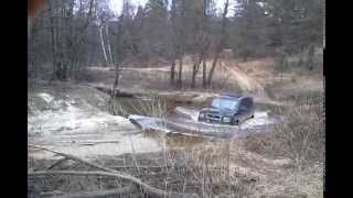 Honda Element crossing the river offroading
