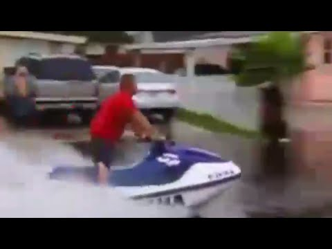 Man Rides Jet Ski on Flooded Streets of Florida