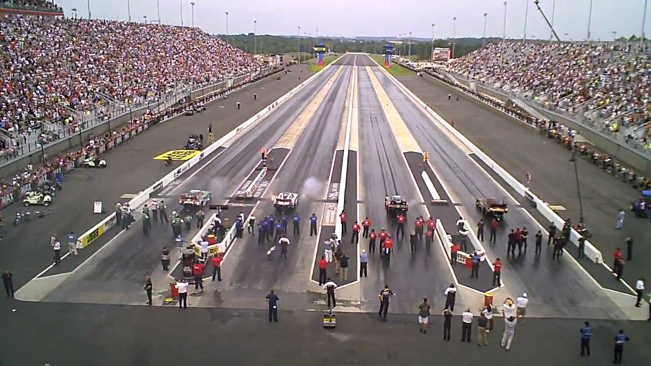Funny cars go four wide at zmax dragway youtube for Charlotte motor speedway drag racing