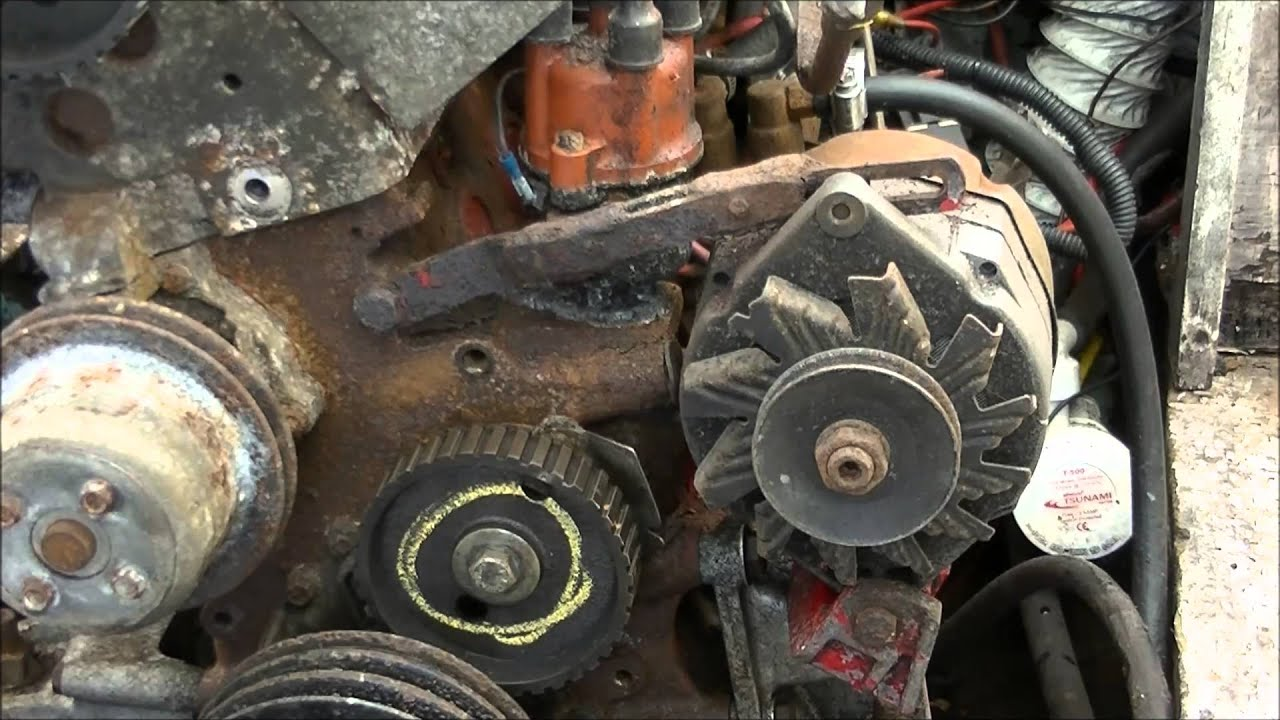 Sprocket wheel and timing belt exchangeCorrea del tiempo y