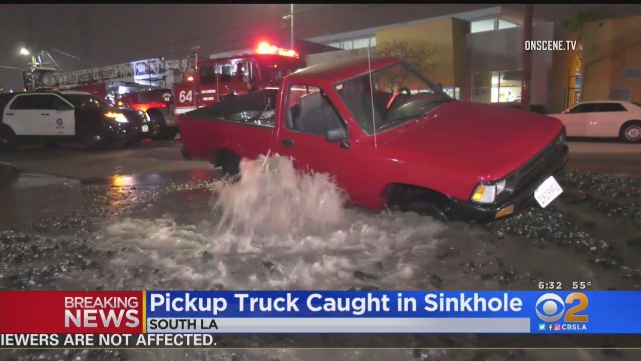 Water Main Break Opens Up Sinkhole That Nearly Swallows Pickup Truck