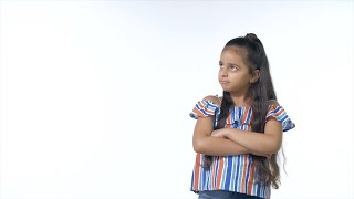 Naughty Indian girl with long hair giving an angry look to the camera - white background