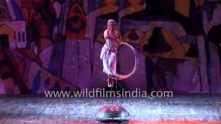 Russian performer spins multiple hula hoops at circus show in India