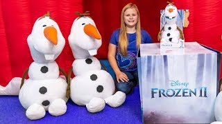 Assistant Opens the Frozen 2 Follow Me Olaf and Elsa Toys