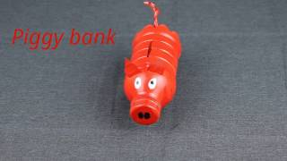 Red DIY Piggy bank for kids from plastic bottle.