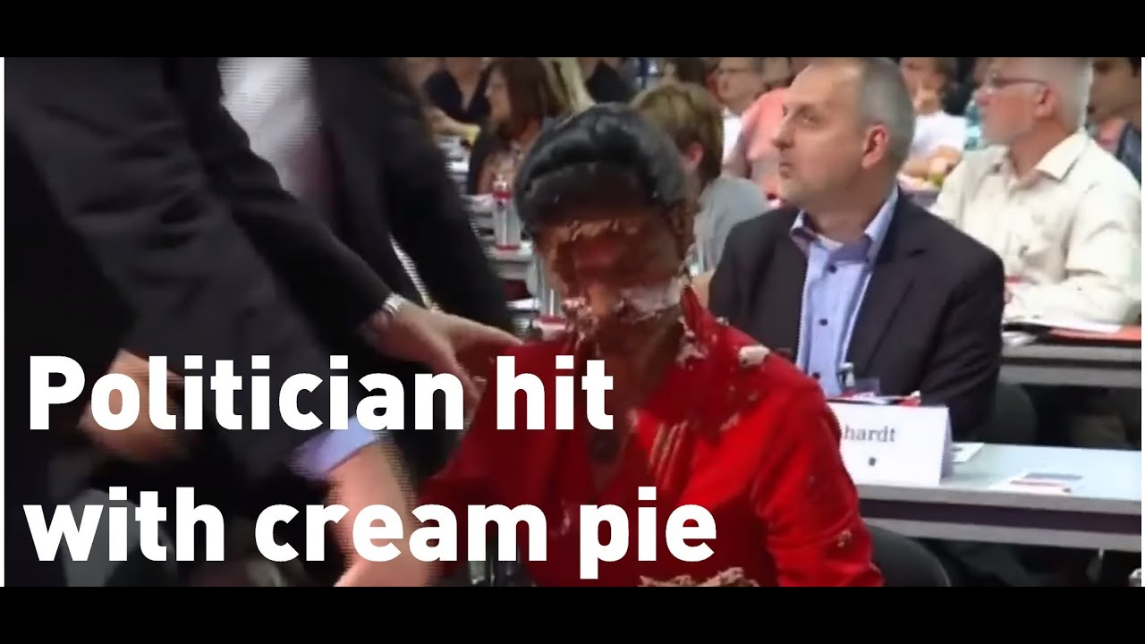 German politician hit in the face with cream pie
