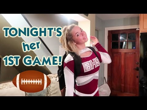 IT'S KATIE CHEERLEADING AT HER FIRST HIGH SCHOOL FOOTBALL GAME