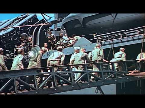 A U.S. Coast Guard photographer on Coast Guard operated  APA and troops ready to ...HD Stock Footage