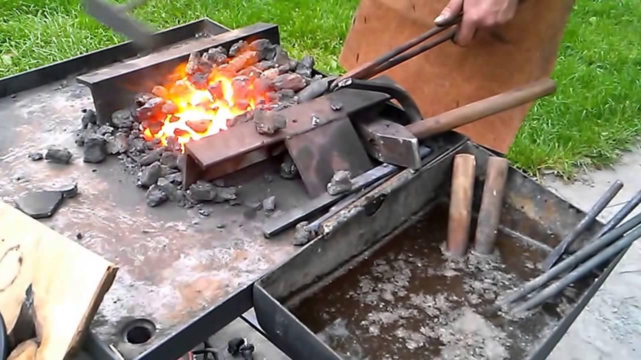 Super Kuj póki żelazo gorące - kucie gwoździa - folklor portal wiano.eu NC49