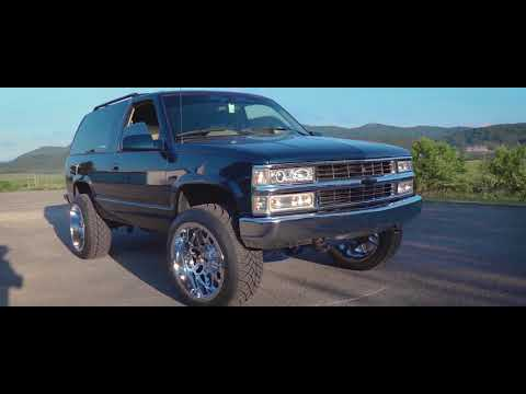 Lifted 2-Door Tahoe Sitting On 22s W/ Wet Paint