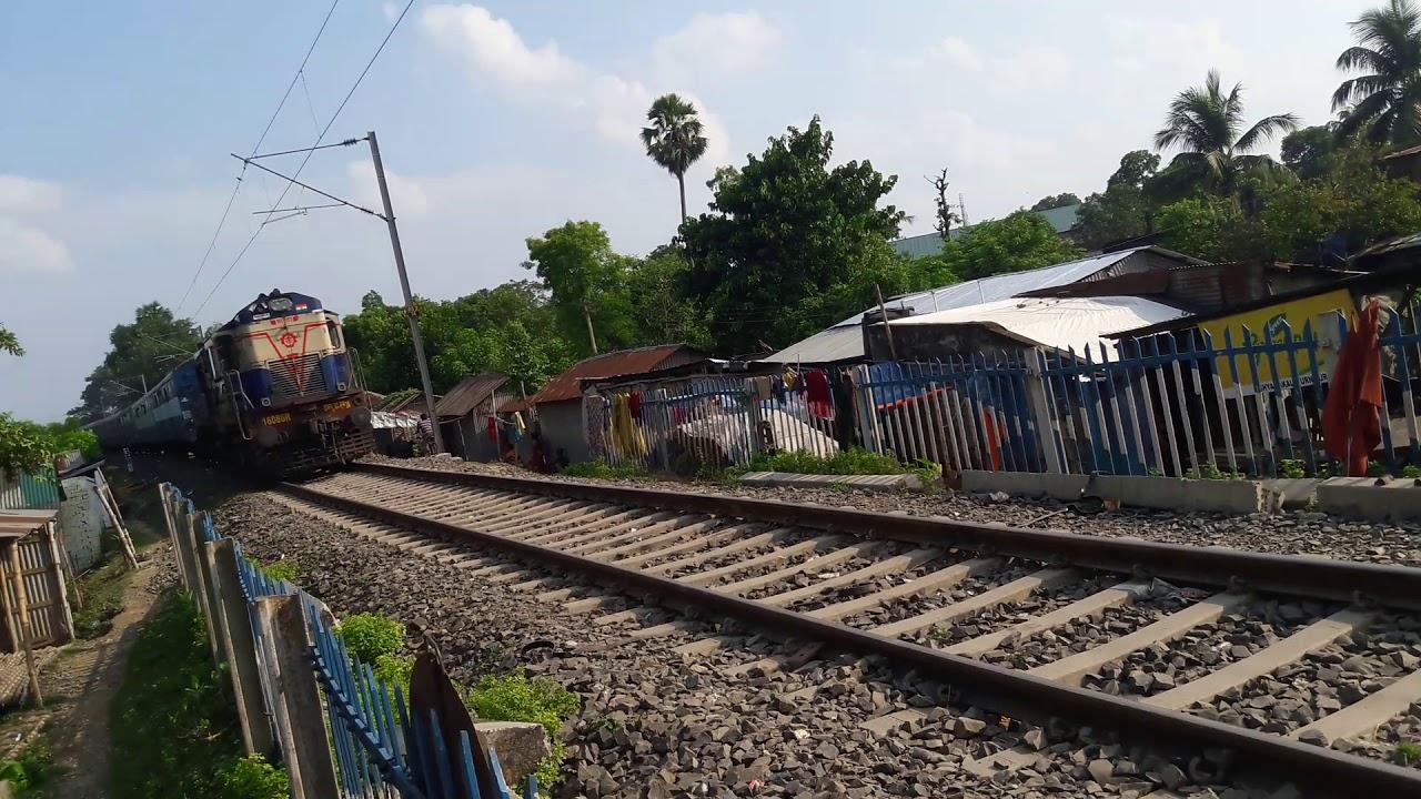 55703 Malda Court Katihar Passenger train passing Naldubi Rail Gate Malda  by Passionate Rohit
