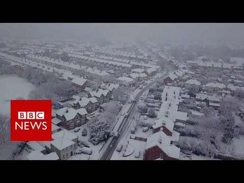 Drone footage captures snowy scenes - BBC News