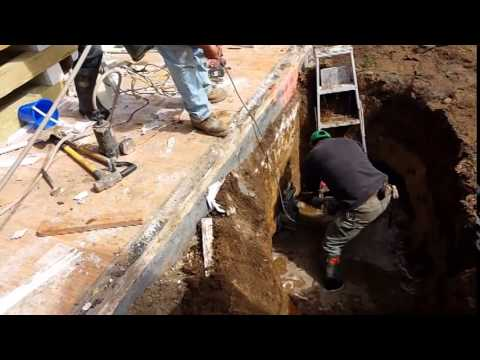 Foundation Repair   Foundation Underpinning Using Helical Piles and Helical Brackets