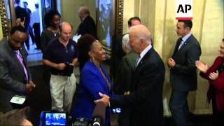 Vice President Joe Biden greeted workers returning to the Environmental Protection Agency with hugs,