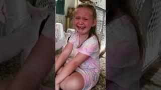 Surprising daughter with  Devon Rex kitten